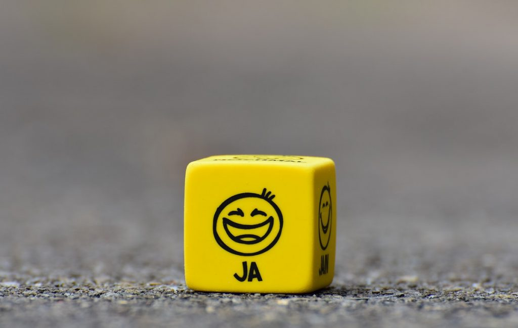 a dice with different emojis